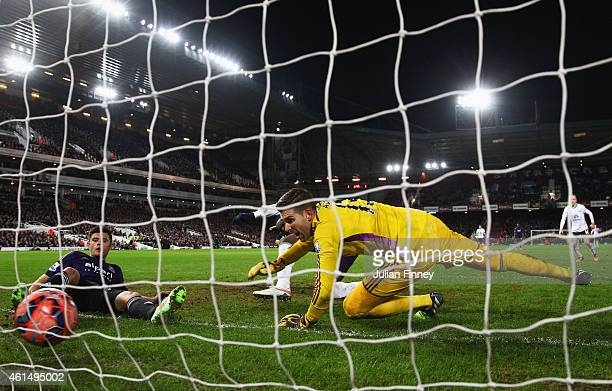 Romelu Lukaku of Everton slides the ball past Adrian and Aaron Cresswell of West Ham United to score their second goal during the FA Cup Third Round...