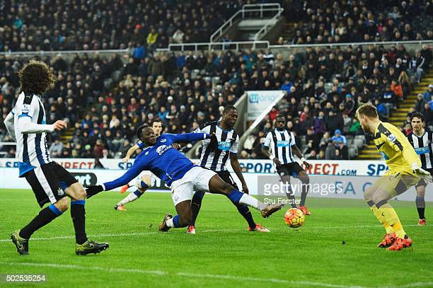Romelu Lukaku of Everton stretches for the ball under pressure from Chancel Mbemba of Newcastle United during the Barclays Premier League match...