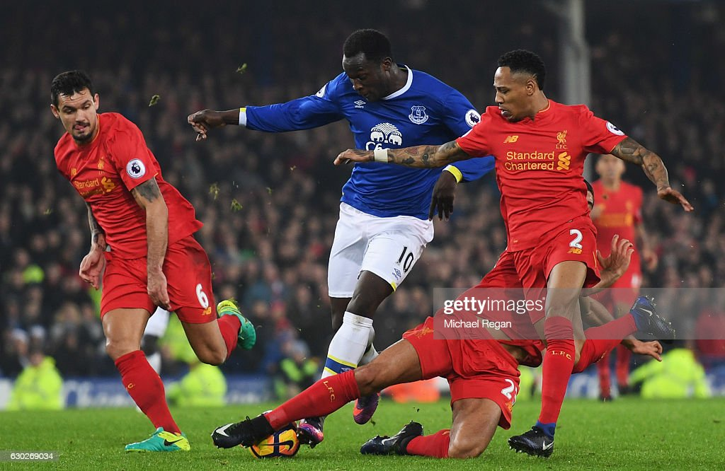 Romelu Lukaku of Everton takes on Dejan Lovren (L), Emre Can (2R) and Nathaniel Clyne of Liverpool (R) during the Premier League match between Everton and Liverpool at Goodison Park on December 19, 2016 in Liverpool, England.
