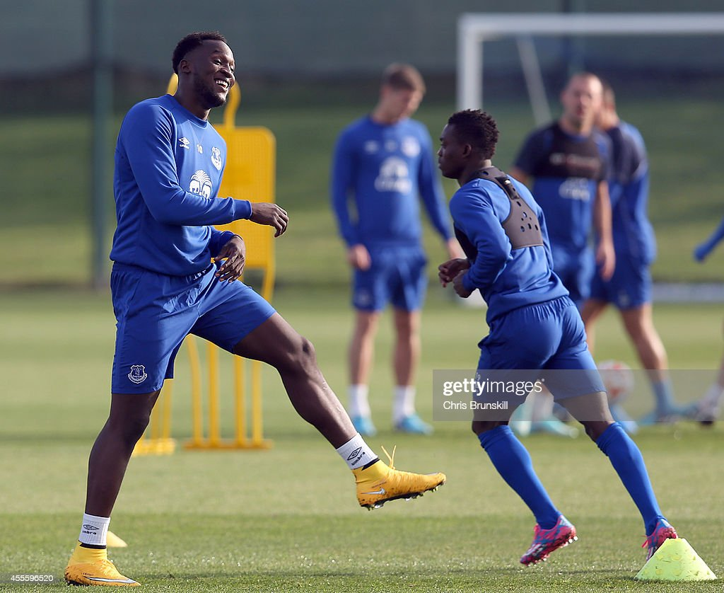 Romelu Lukaku (L) of Everton warms up during a training session at Finch Farm on September 17, 2014 in Liverpool, England.