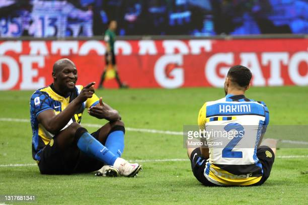 Romelu Lukaku of FC Internazionale celebrates after scoring their sides third goal with team mate Achraf Hakimi during the Serie A match between FC...