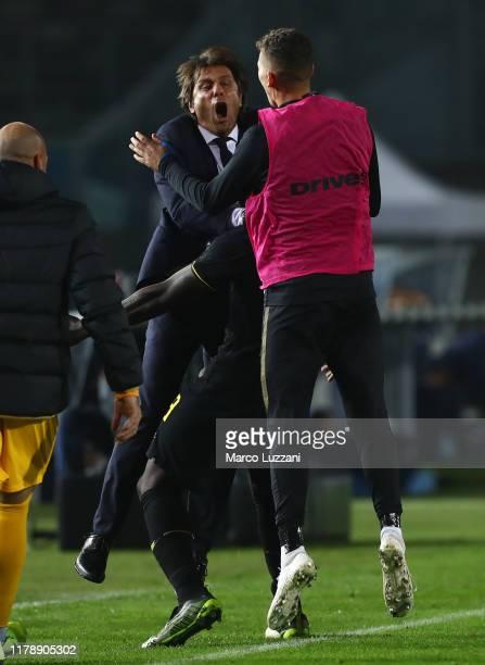 Romelu Lukaku of FC Internazionale celebrates his goal with FC Internazionale coach Antonio Conte and Sebastiano Esposito during the Serie A match...