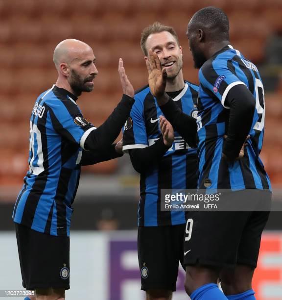 Romelu Lukaku of FC Internazionale celebrates his goal with his teammates Christian Eriksen and Borja Valero during the UEFA Europa League round of...