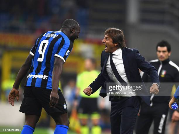 Romelu Lukaku of FC Internazionale celebrates with head coach Antonio Conte after scoring the second goal of his team during the Serie A match...