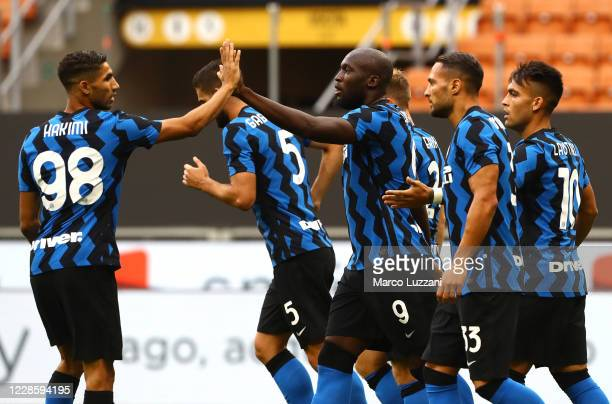 Romelu Lukaku of FC Internazionale celebrates with his team-mate Achraf Hakimi after scoring the opening goal during the friendly match between FC...