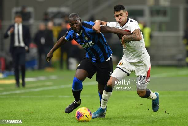 Romelu Lukaku of FC Internazionale challenged by Cristian Romero of Genoa CFC during the Serie A match between FC Internazionale and Genoa CFC at...