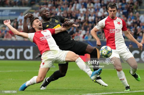 Romelu Lukaku of FC Internazionale competes for the ball with David Hovorka and Ondrej Kudela of SK Slavia Praha during the UEFA Champions League...