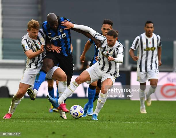 Romelu Lukaku of FC Internazionale competes for the ball with Matthijs de Ligt and Adrien Rabiot of Juventus during the Serie A match between...