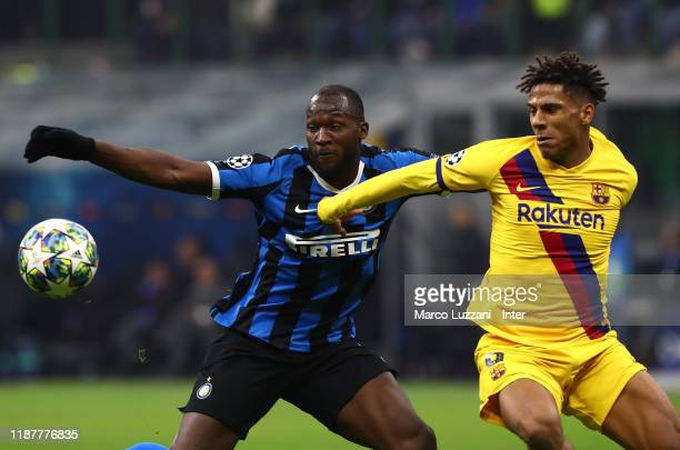 Romelu Lukaku of FC Internazionale competes for the ball with Jean Clair Todibo of Barcelona during the UEFA Champions League group F match between...