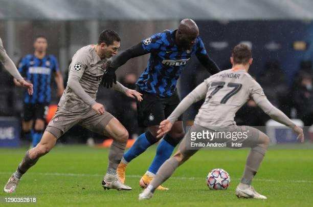 Romelu Lukaku of FC Internazionale competes for the ball with Taras Stepanenko and Valeriy Bondar of FC Shakhtar Donetsk during the UEFA Champions...