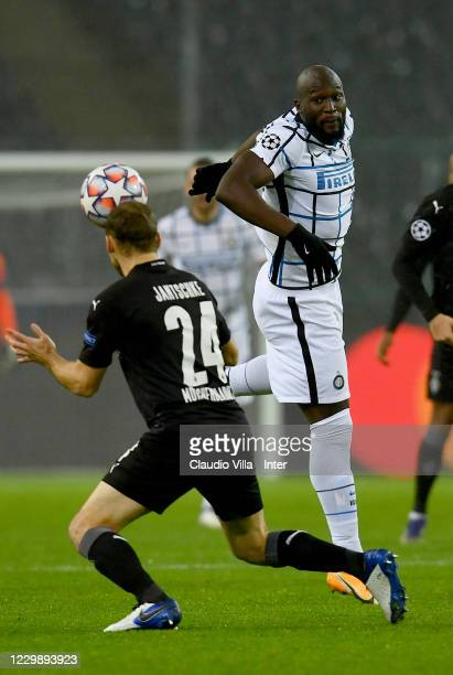 Romelu Lukaku of FC Internazionale competes for the ball with Tony Jantschke of Borussia Moenchengladbach during the UEFA Champions League Group B...