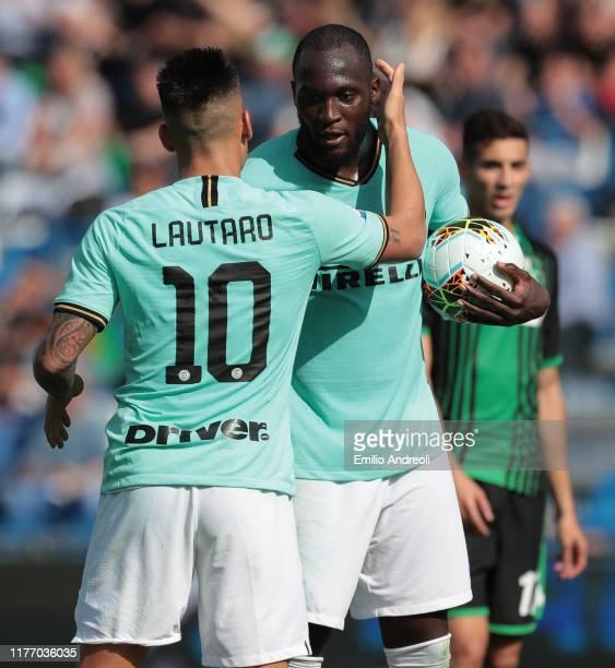 Romelu Lukaku of FC Internazionale embraces Lautaro Martinez of FC Internazionale during the Serie A match between US Sassuolo and FC Internazionale...