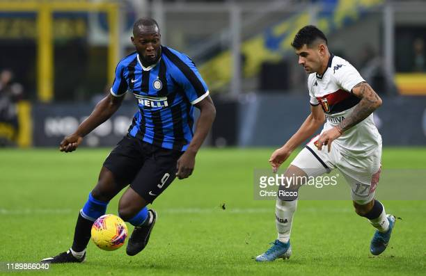 Romelu Lukaku of FC Internazionale evades challenge from Cristian Romero of Genoa CFC during the Serie A match between FC Internazionale and Genoa...