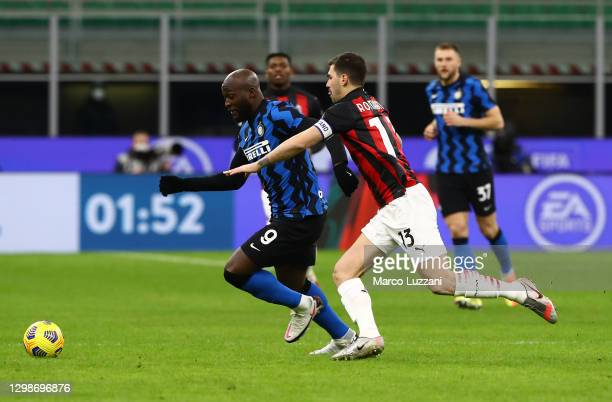 Romelu Lukaku of FC Internazionale is challenged by Alessio Romagnoli of AC Milan during the Coppa Italia match between FC Internazionale and AC...