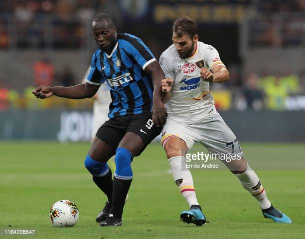 Romelu Lukaku of FC Internazionale is challenged by Panagiotis Tachtsidis of US Lecce during the Serie A match between FC Internazionale and US Lecce...