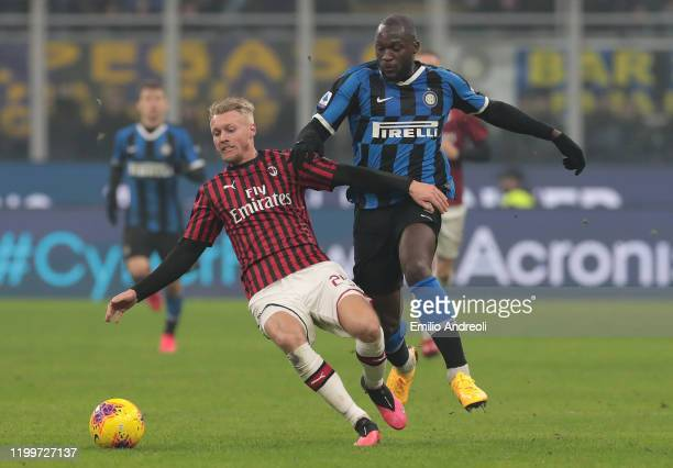 Romelu Lukaku of FC Internazionale is challenged by Simon Kjaer of AC Milan during the Serie A match between FC Internazionale and AC Milan at Stadio...