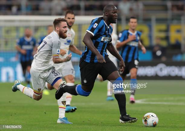 Romelu Lukaku of FC Internazionale is challenged by Zan Majer of US Lecce during the Serie A match between FC Internazionale and US Lecce at Stadio...