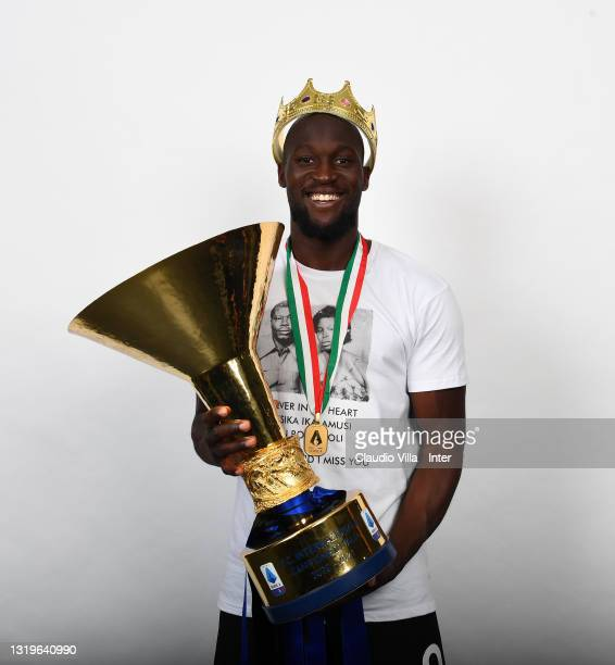 """Romelu Lukaku of FC Internazionale poses with the trophy for the victory of """"scudetto"""" at the end of the last Serie A match between FC Internazionale..."""