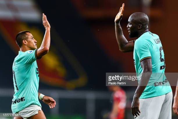 Romelu Lukaku of Inter celebrates with his team-mate Alexis Sanchez after scoring his second goal during the Serie A match between Genoa CFC and FC...