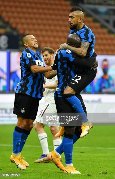 Romelu Lukaku of Inter Milan celebrates after scoring their sides third goal with team mates Arturo Vidal and Alexis Sanchez during the Serie A match...