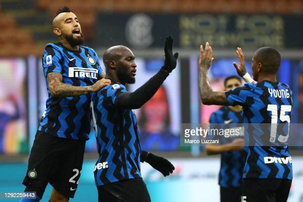 Romelu Lukaku of Inter Milan celebrates with Arturo Vidal and Ashley Young after scoring their sides second goal from a penalty during the Serie A...