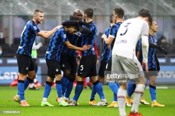 Romelu Lukaku of Inter Milan celebrates with teammates after scoring their team's first goal during the Serie A match between FC Internazionale and...