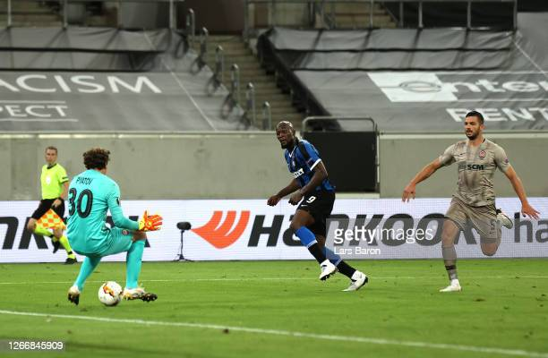 Romelu Lukaku of Inter Milan scores his team's fifth goal past Andriy Pyatov of Shakhtar Donetsk during the UEFA Europa League Semi Final between...