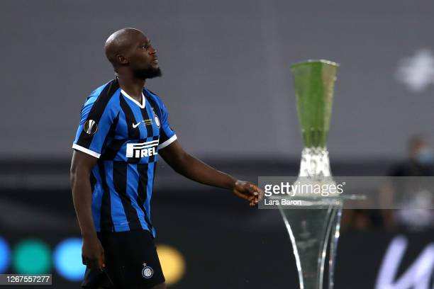 Romelu Lukaku of Inter Milan walks past the UEFA Europa League Trophy prior to the UEFA Europa League Final between Seville and FC Internazionale at...