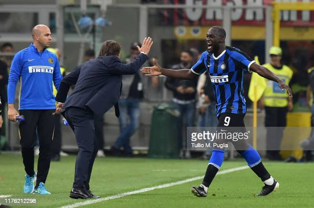 Romelu Lukaku of Internazionale celebrates with head coach Antonio Conte after scoring his team's second goal during the Serie A match between AC...