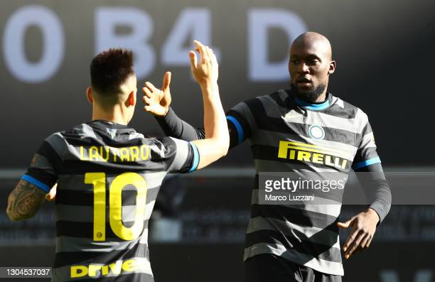 Romelu Lukaku of Internazionale celebrates with team mate Lautaro Martinez after scoring their side's first goal during the Serie A match between FC...