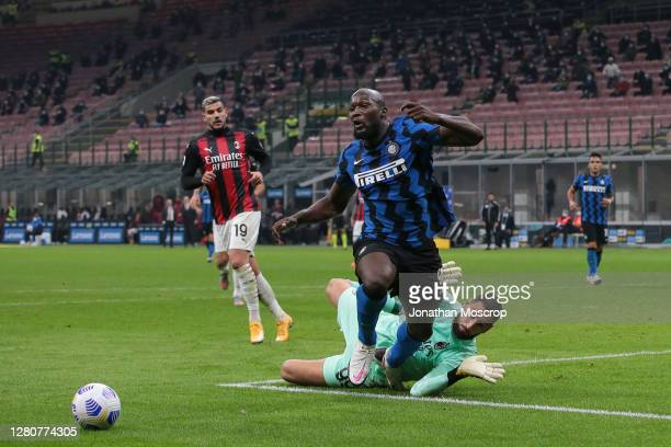 Romelu Lukaku of Internazionale goes down in the penalty area as he is challegned by Gianluigi Donnarumma of AC Milan during the Serie A match...