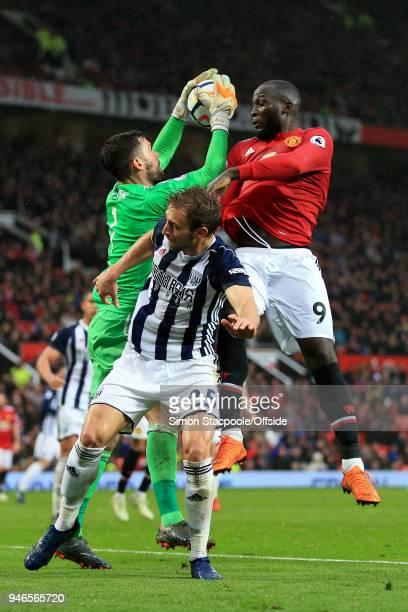 Romelu Lukaku of Man Utd battles with Craig Dawson of West Brom and West Brom goalkeeper Ben Foster during the Premier League match between...