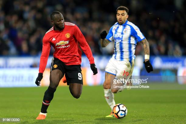 Romelu Lukaku of Man Utd battles with Daniel Williams of Huddersfield during The Emirates FA Cup Fifth Round match between Huddersfield Town and...