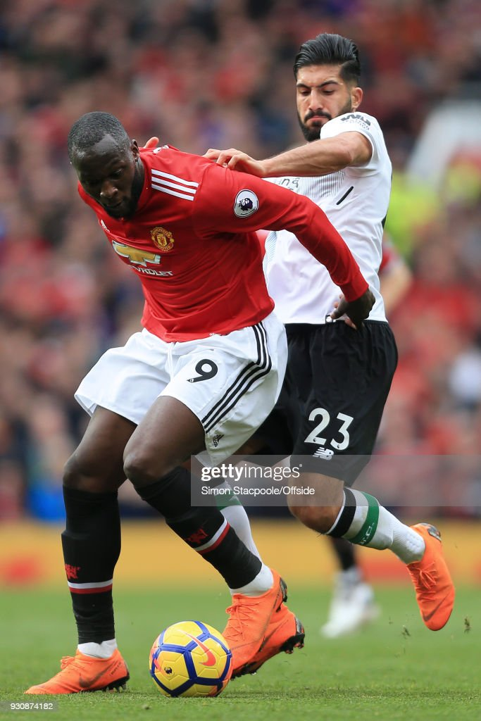 Romelu Lukaku of Man Utd battles with Emre Can of Liverpool during the Premier League match between Manchester United and Liverpool at Old Trafford on March 10, 2018 in Manchester, England.