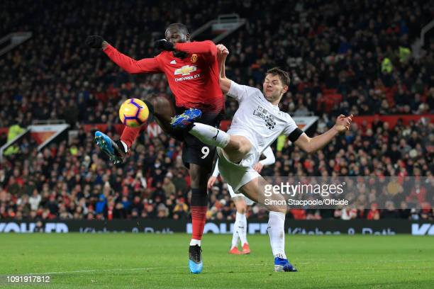 Romelu Lukaku of Man Utd battles with James Tarkowski of Burnley during the Premier League match between Manchester United and Burnley at Old...
