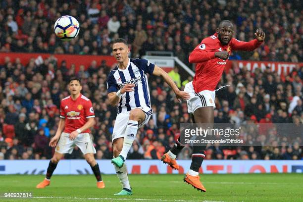 Romelu Lukaku of Man Utd beats Kieran Gibbs of West Brom to a header during the Premier League match between Manchester United and West Bromwich...