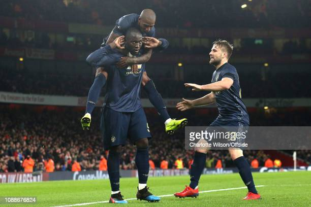 Romelu Lukaku of Man Utd mocks the Arsenal fans by holding his hands to his ears as he celebrates their 2nd goal with Ashley Young during the FA Cup...