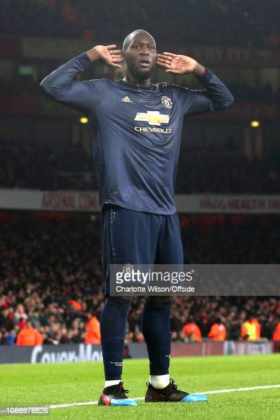 Romelu Lukaku of Man Utd mocks the Arsenal fans by holding his hands to his ears as he celebrates their 2nd goal during the FA Cup Fourth Round match...