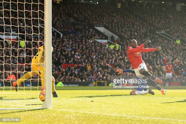 Romelu Lukaku of Man Utd scores their 1st goal during the Premier League match between Manchester United and Chelsea at Old Trafford on February 25...
