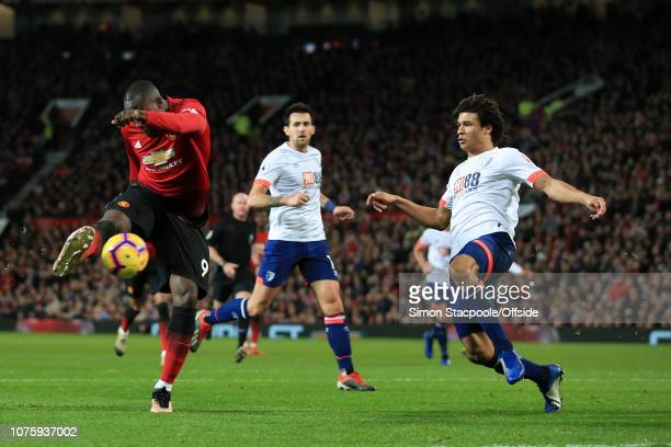 Romelu Lukaku of Man Utd scores their 4th goal past Nathan Ake of Bournemouth during the Premier League match between Manchester United and AFC...