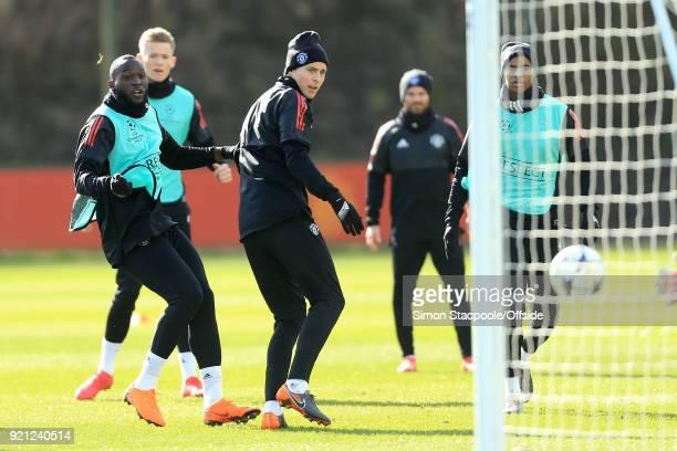 Romelu Lukaku of Man Utd shoots past Victor Lindelof of Man Utd during a training session ahead of their UEFA Champions League match against Sevilla...