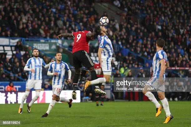 Romelu Lukaku of Manchester United and Christopher Schindler of Huddersfield Town during the Premier League match between Huddersfield Town and...