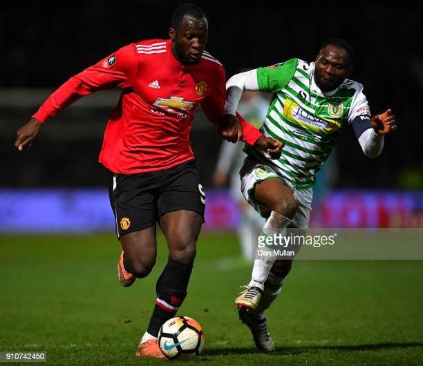 Romelu Lukaku of Manchester United and Francois Zoko of Yeovil Town in action during The Emirates FA Cup Fourth Round match between Yeovil Town and...