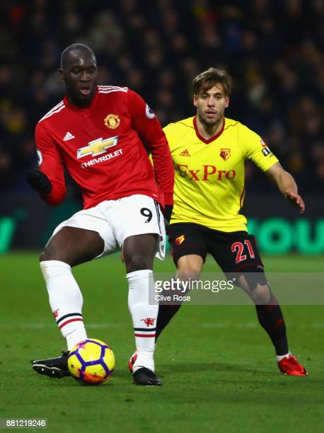 Romelu Lukaku of Manchester United and Kiko Femenia of Watford in action during the Premier League match between Watford and Manchester United at...