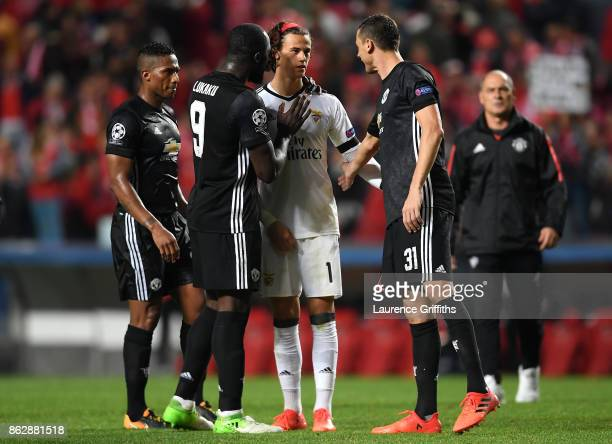 Romelu Lukaku of Manchester United and Nemanja Matic of Manchester Unitd console Mile Svilar of Benfica after the UEFA Champions League group A match...