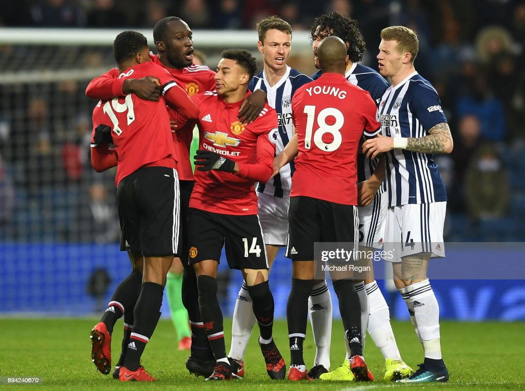 Romelu Lukaku of Manchester United and teammate Jesse Lingard hold back Marcus Rashford during a confrontation with Ahmed El-Sayed Hegazi of West Bromwich Albion during the Premier League match between West Bromwich Albion and Manchester United at The Hawthorns on December 17, 2017 in West Bromwich, England.