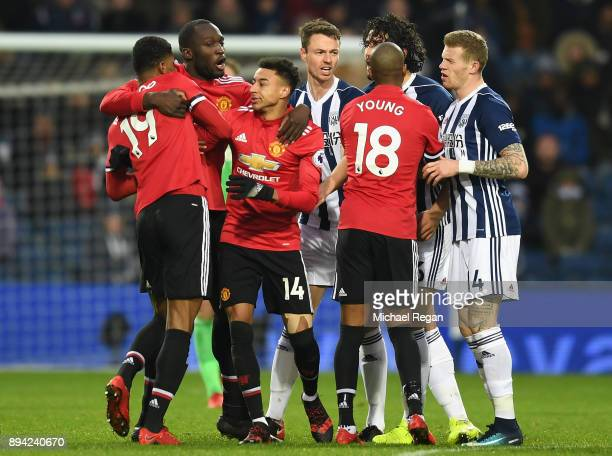 Romelu Lukaku of Manchester United and teammate Jesse Lingard hold back Marcus Rashford during a confrontation with Ahmed ElSayed Hegazi of West...