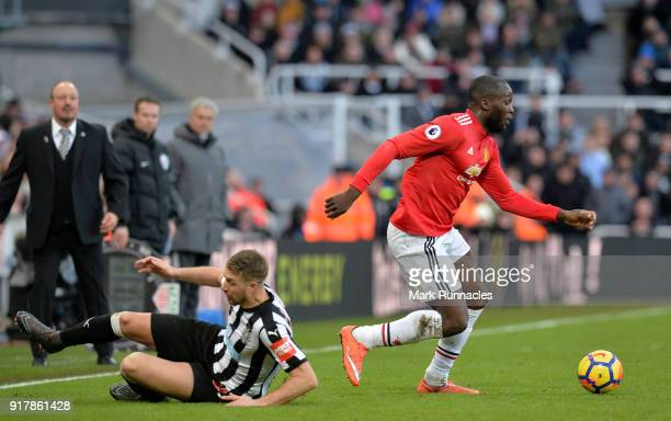 Romelu Lukaku of Manchester United avoids a tackle from Florian Lejeune of Newcastle United during the Premier League match between Newcastle United...