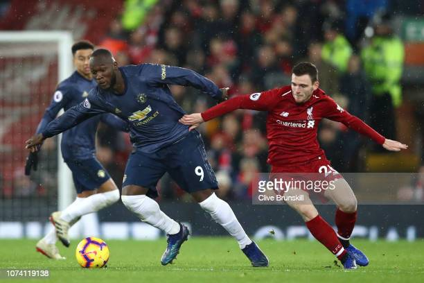 Romelu Lukaku of Manchester United battles for possession with Andy Robertson of Liverpool during the Premier League match between Liverpool FC and...