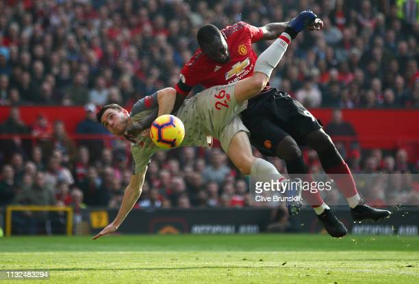 Romelu Lukaku of Manchester United battles for possession with Andy Robertson of Liverpool during the Premier League match between Manchester United...